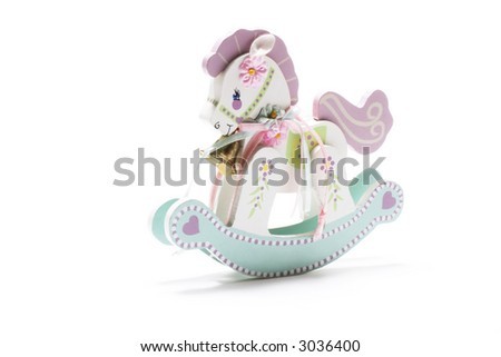 Miniature Rocking Horse with white background - stock photo