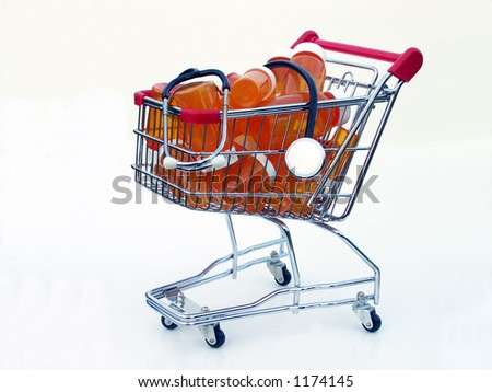 Miniature shopping cart isolated on white filled with prescription bottles and a stethoscope illustrating shopping for a health care provider or pharmacy.