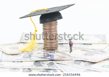 Miniature student saving for his education fund  - stock photo