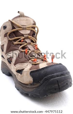 Miniature technician repairing  boot shoe  - stock photo