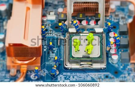 Miniature technician repairing computer - stock photo