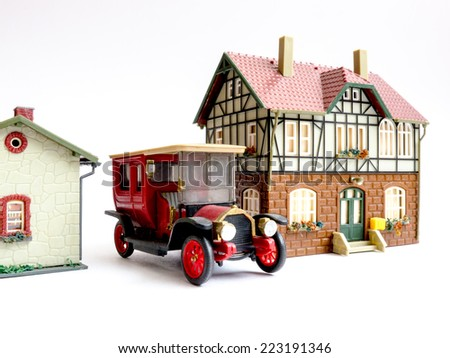 Miniature toy (House and Automobile).  - stock photo