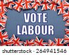 Miniature Union Jack flags form a border on blue card around the  phrase Vote Labour for the UK General Election - stock photo