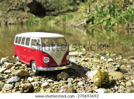 Miniature VW Bulli 1962 in the forest. The cult car of the Hippie generation and it remained the status vehicle of the high wave surfers - stock photo