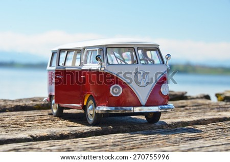 Miniature VW Bulli 1962 on the wooden pier. The cult car of the Hippie generation and it remained the status vehicle of the high wave surfers - stock photo