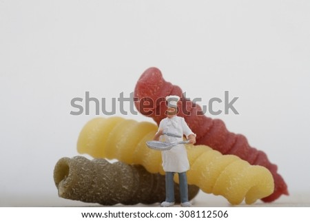 miniatures of chef with tricolored pasta - stock photo
