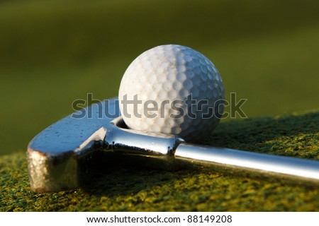Minigolf club with ball - stock photo