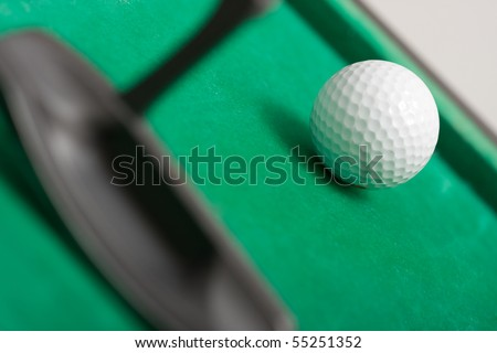 Minigolf - golf ball and a putter - stock photo