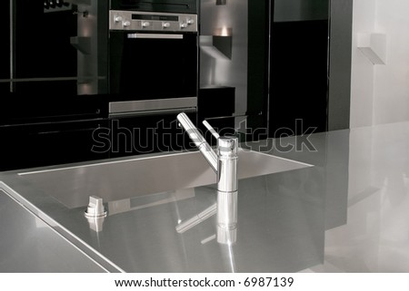 Minimalism design of modern black kitchen cabinets - stock photo