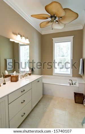 minimalist bathroom with tile floor and ceiling fan