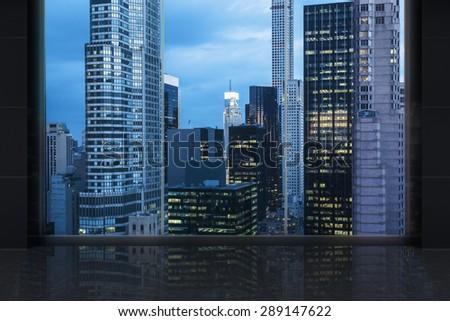 Minimalist interior with a huge window and panoramic New York city. - stock photo