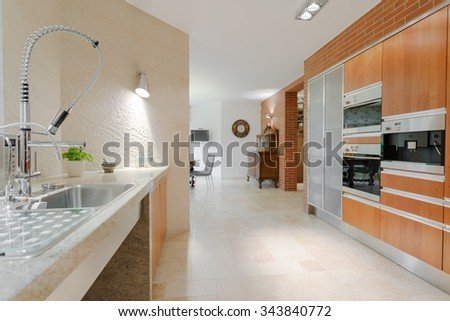 Minimalistic design contemporary kitchen with modern equipment - stock photo