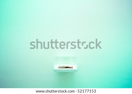 Minimalistic interior with book on the wall - stock photo
