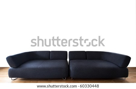 minimalistic living room with black couch and wooden floor - stock photo