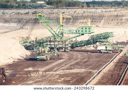 mining machinery in open pit mine - stock photo