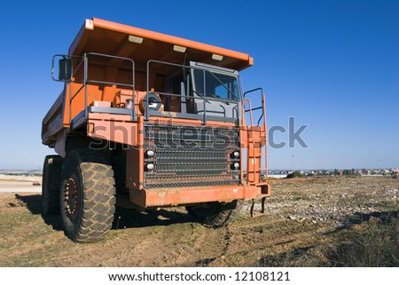 Mining truck at work-site - stock photo