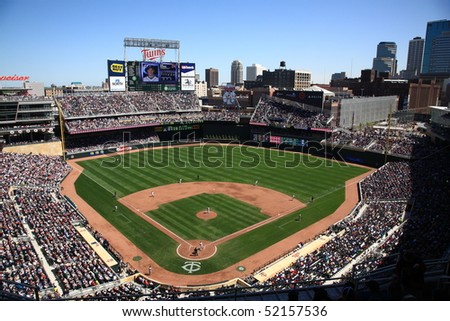 MINNEAPOLIS - APRIL 22: Full house gathered at new Target Field, home of the Minnesota Twins, a ballpark that returns outdoor baseball to the city, on April 22, 2010 in Minneapolis, Minnesota. - stock photo