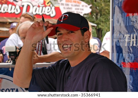 MINNEAPOLIS - AUGUST 16:  Pitcher Jeff Manship of the Minnesota Twins signs autographs at the Metrodome August 16, 2009 in Minneapolis. - stock photo