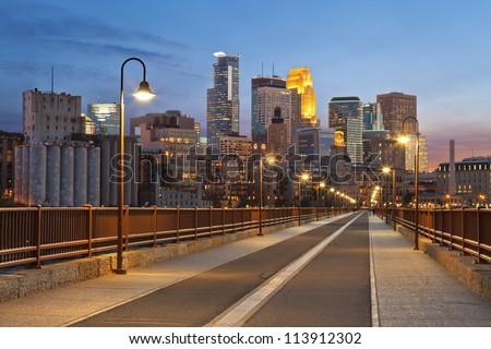 Minneapolis. Image of Minneapolis skyline taken from Stone Arch Bridge at sunset . - stock photo