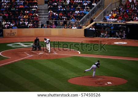 MINNEAPOLIS - JULY 17:  Orlando Hudson of the Twins connects off a pitch from Mark Buehrle of the Chicago White Sox in a game at Target Field July 17, 2010 in Minneapolis, MN. - stock photo