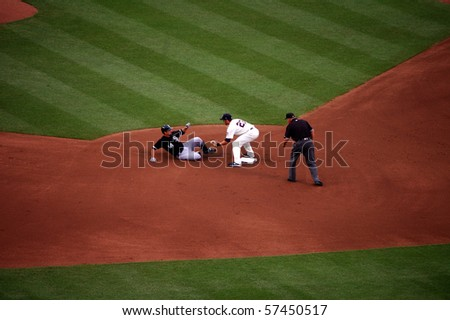MINNEAPOLIS - JULY 17:  Paul Konerko of the White Sox  is thrown out at second on a throw from Twins catcher Drew Butera and the tag by shortstop J.J. Hardy July 17, 2010 in Minneapolis, MN. - stock photo