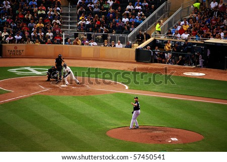 MINNEAPOLIS - JULY 17:  White Sox pitcher Mark Buehrle watches along with Twins hitter Orlando Hudson after Hudson connects on a pitch at Target Field July 17, 2010 in Minneapolis, MN. - stock photo