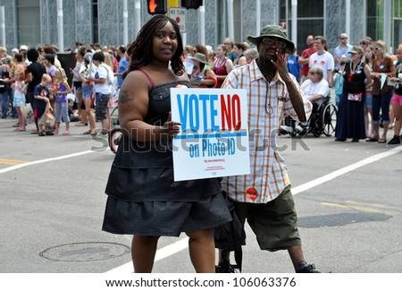 MINNEAPOLIS - JUNE 24:  Supporters of a No vote on Photo ID march in the Gay Pride Parade on June 24, 2012, in Minneapolis.  A Photo ID requirement for voting will be on the ballot in Mn. in November. - stock photo