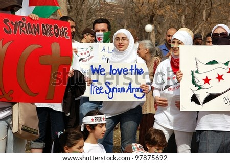 MINNEAPOLIS - MARCH 17:    Unidentified Participants at a global demonstration to mark the first year of the Syrian Revolution, on March 17, 2102 in Minneapolis. - stock photo