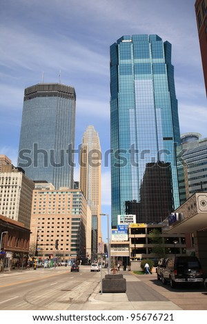 """MINNEAPOLIS, MINNESOTA - APRIL 21: Busy city streets on April 21, 2010 in Minneapolis, Minnesota. Nicknamed the """"Mill City,"""" Minneapolis is the primary business center between Chicago and Seattle. - stock photo"""