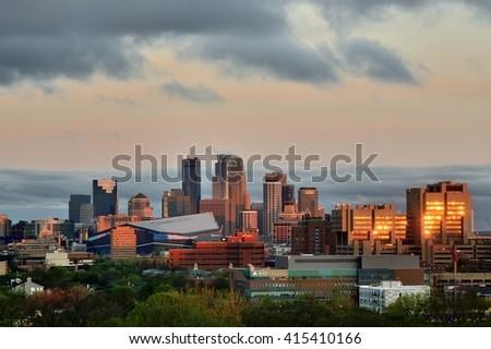MINNEAPOLIS, MN - APRIL 22 2016: Downtown Minneapolis Skyline with Minnesota Vikings US Bank Stadium and the University of Minnesota - stock photo