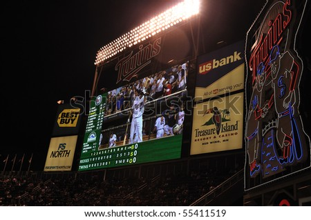 MINNEAPOLIS, MN - JUNE 15: View of Joe Mauer on Target Field Scoreboard at night during a Major League Baseball game vs the Colorado Rockies and the Minnesota Twins on June 15, 2010 in Minneapolis, MN - stock photo