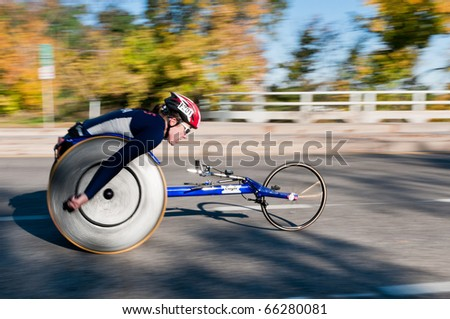 MINNEAPOLIS, MN - OCTOBER 3: Christina Ripp speeds by at Mile 19 and goes on to finish 1st in the Wheelchair Division of the 2010 Medtronic Twin Cities Marathon, October 3, 2010 in Minneapolis, MN - stock photo