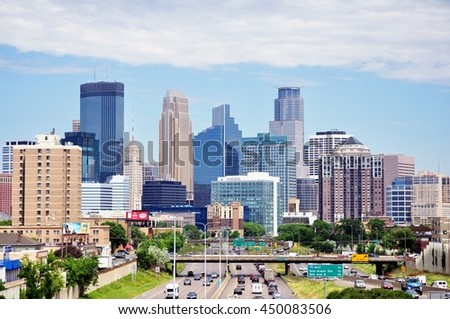 MINNEAPOLIS, MN, USA - JUNE 30 2016: Downtown Minneapolis Minnesota Skyline on a Sunny Morning - stock photo