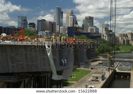Minneapolis with the 35W Bridge under construction in the foreground
