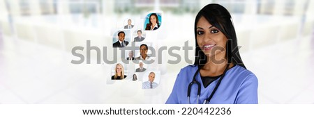 Minority nurse working at her job in a hospital - stock photo