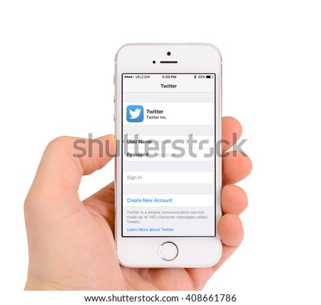 Minsk, Belarus - April 16, 2016: Apple iPhone 5S with page Twitter. The founders of the company: Steve Jobs, Ronald Wayne, Steve Wozniak. Apple Inc. Located in USA. - stock photo