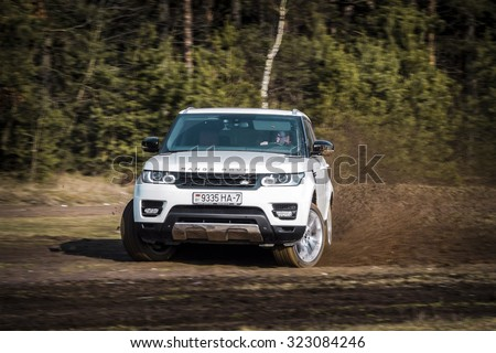 MINSK, BELARUS - APRIL 6, 2014: 2015 model year Range Rover Sport 3.0 Supercharged goes off-road. British SUV is powered by 3.0 liter V6 (340 hp & 450 Nm). - stock photo