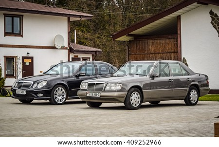MINSK, BELARUS - APRIL 21, 2016: two generations of Mercedes-Benz E-class - 1993 W124 and 2005 W211 - are on display during a presentation event in Minsk, Belarus. - stock photo