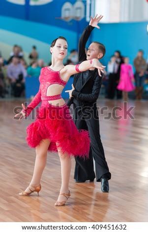 Minsk, Belarus-??April 3, 2016: Unidentified Dance Couple Performs Juvenile-1 Latin-American Program on the IDSA Championship Kinezis Star Cup -2016 in April 3, 2016 in Minsk, Republic of Belarus - stock photo