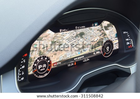 MINSK, BELARUS - AUGUST 28, 2015: 2015 model year all-new Audi Q7 3.0 TFSI 12.3-inch virtual cockpit digital dashboard with navigation map on display at test drive event for automotive journalists. - stock photo