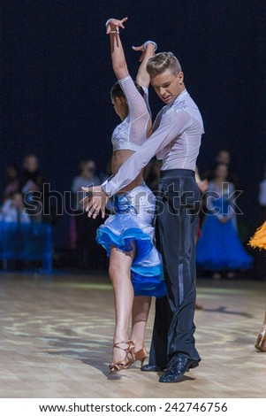 Minsk-Belarus,December 20,2014:Belarussian couple of Bachilo Egor and Kravchenko Anna performs Youth-2 Latin-American program on Gold of The Capital IDSA Tournament on December 20,2014,Minsk,Belarus - stock photo