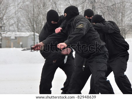 MINSK, BELARUS - JAN 18: Open day in subdivision 3214. Russian S.W.A.T. demonstrates their skills at the open day in Minsk, Belarus. On January 18, 2010. - stock photo