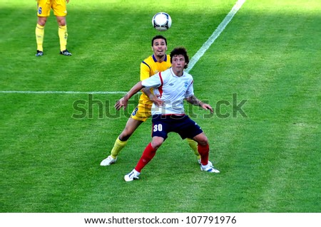 MINSK, BELARUS - JULY 1: Leonid Kovel (FC Minsk (white) takes the ball during the match between FC NAFTAN and FC MINSK on July 1, 2012 in Minsk, Belarus