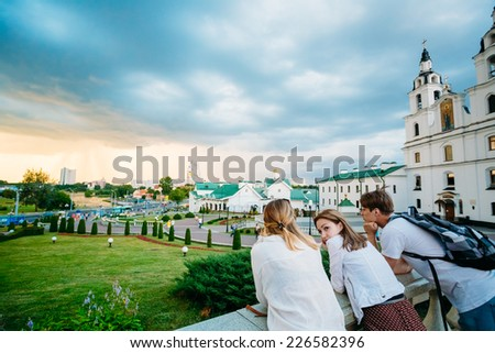 MINSK, BELARUS - JULY 19, 2014: Young people are watching the approaching storm near The Cathedral Of Holy Spirit - The Famous Main Orthodox Church Of Belarus And Symbol Of Capital