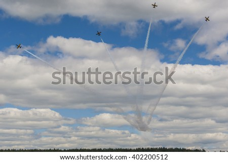 Minsk, Belarus-June 21, 2014: Acrobatic Stunt Planes RUS of Aero L-159 ALCA on Air During Aviation Sport Event to the 80th Anniversary of DOSAAF Foundation in Minsk on June 21, 2014 in Minsk, Belarus