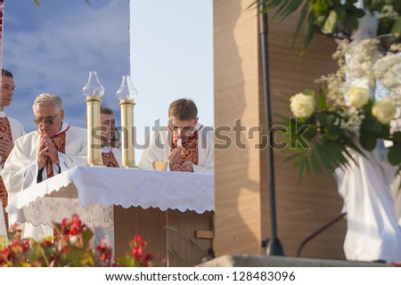 MINSK-BELARUS-JUNE 21:Catholic Bishops taking bread on Minsk Catholic church opening, June 21, 2008 in Minsk, Republic of Belarus - stock photo