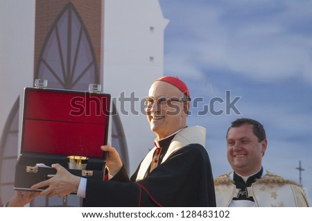 MINSK-BELARUS-JUNE 21:Roman Cardinal Tarcisio Bertone opens newly built Minsk Catholic church and receives gift, June 21, 2008 in Minsk, Republic Of Belarus - stock photo