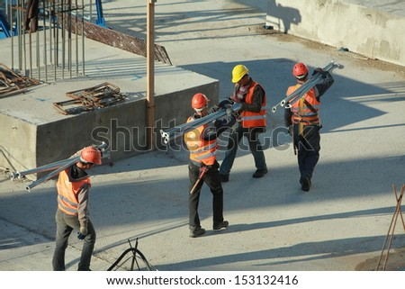 MINSK, BELARUS-JUNE 9, 2013: Workers at a construction site in Minsk, Belarus.