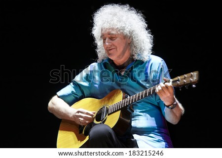 "MINSK, BELARUS - MARCH 21, 2014: Brian May from Queen performs with Kerry Elils during ""Acoustic by Candlelight Tour"" at the Republic Palace on March 21, 2014 in Minsk, Belarus - stock photo"
