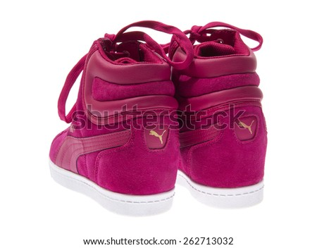Minsk, Belarus - March 18, 2015: Pink Female Beautiful Shoes Puma with High Heels. Isolated on White Background. Puma - a German company that specializes in athletic footwear, apparel and accessories.